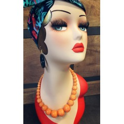 Carved Poppy Orange Fakelite Beads